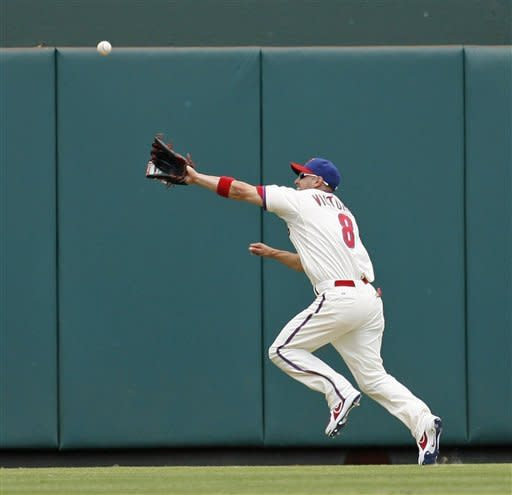 Rollins leads Phillies over Giants 4-3 in 12