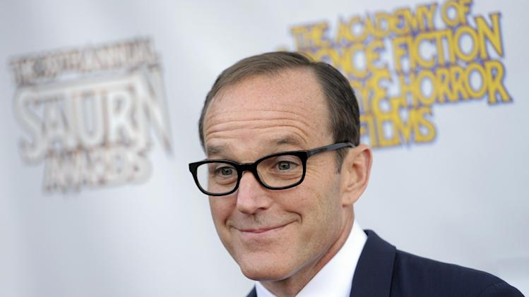 "FILE - In this June 26, 2013 file photo, actor Clark Gregg poses at the 39th Saturn Awards at The Castaway, in Burbank, Calif. Five years ago, Gregg played Agent Phil Coulson for the first time as a small role in the Robert Downey Jr. romp ""Iron Man."" Now, after gaining an ever-higher profile as Coulson in subsequent projects including last year's mega-hit ""The Avengers,"" Gregg has broken out as the star of ""Marvel's Agents of S.H.I.E.L.D.,"" the new ABC sci-fi thriller (airing Tuesdays at 8 p.m. EDT), which finds Coulson leading a hand-picked band of agents on their extra-special missions. (Photo by Chris Pizzello/Invision/AP, File)"