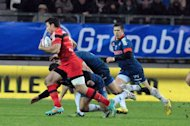 Grenoble's fly-half Valentin Courrent (R) runs during their French Top 14 rugby union match against Stade Toulousain on December 22, 2012 at the Stade des Alpes stadium in Grenoble, central eastern France. Two-time defending French champions Toulouse slipped to their fifth defeat in all competitions this season on Saturday as newboys Grenoble beat them 15-6 in their Top 14 clash