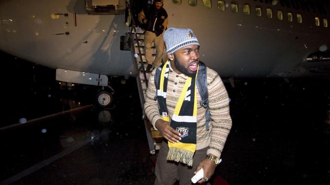 Simoni Lawrence of the Hamilton Tiger Cats arrives at the Vancouver International Airport prior to the 102nd Grey Cup game in Vancouver.
