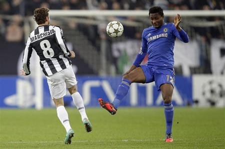 Juventus' Marchisio challenges Chelsea's Mikel during their Champions League soccer match at the Juventus stadium in Turin