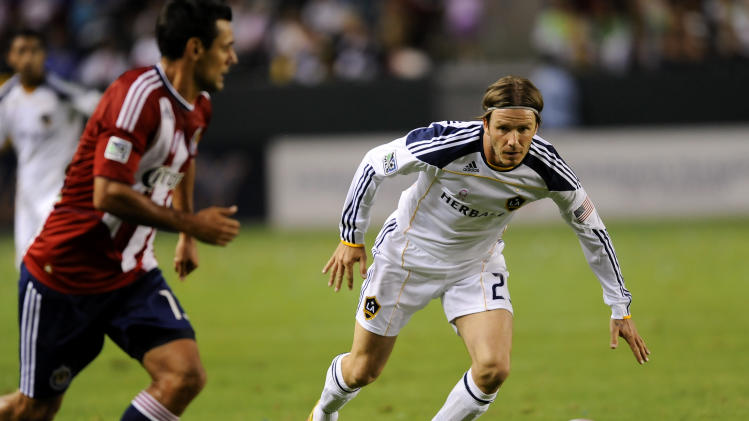 Los Angeles Galaxy midfielder David Beckham, right, of England, attempts to get the ball by Chivas USA defender Ante Jazic, left, during the first half of an MLS soccer match, Sunday, Oct. 16, 2011, in Carson, Calif. The Galaxy won 1-0. (AP Photo/Gus Ruelas)