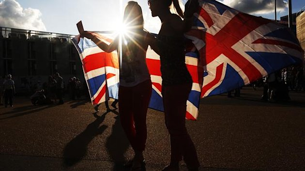Supporters of Team GB wave Union flags in the Olympic Park