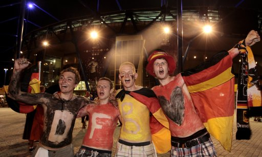Germany fans celebrate their team's victory at the end of their Euro 2012 soccer match against the Netherlands at the Metalist stadium in Kharkiv