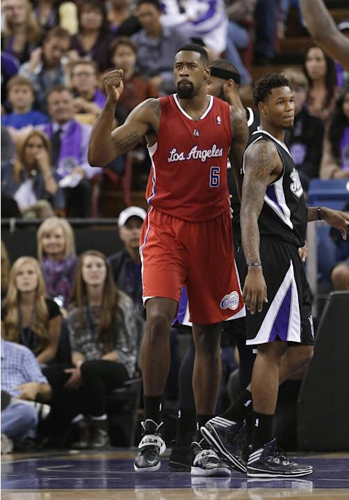 Los Angeles Clippers center DeAndre Jordan, left, pumps his fist after scoring and getting fouled to break a 98-98 tie against the Sacramento Kings during overtime in an NBA basketball game in Sacrame