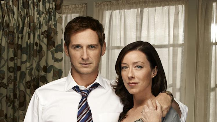 "Josh Lucas as Mitch McDeere and Molly Parker as Abby McDeere in ""The Firm."""