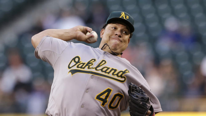 Oakland Athletics starting pitcher Bartolo Colon throws against the Seattle Mariners in the sixth inning of a baseball game Friday, June 21, 2013, in Seattle. (AP Photo/Elaine Thompson)