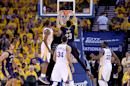 Anthony Davis #23 of the New Orleans Pelicans goes up to slam dunk the ball against the Golden State Warriors during the first round of the 2015 NBA Playoffs on April 18, 2015 in Oakland, California