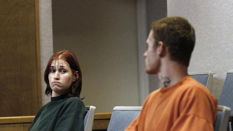 "FILE - In this Oct. 11, 2011 file photo, Holly Grigsby, left, looks at her boyfriend, David ""Joey"" Pedersen, during an appearance in Yuba County Superior Court in Marysville, Calif. On Tuesday, July 15, 2014, a federal judge in Portland, Ore. sentenced Grigsby to life in prison for her role in a Pacific Northwest killing spree that authorities say was part of a white supremacist scheme. Pedersen is scheduled to be sentenced in August 2014. (AP Photo/Rich Pedroncelli, File)"
