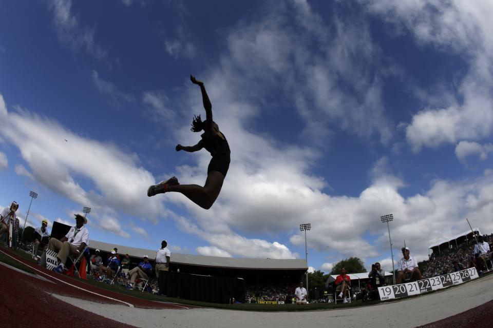 Brittney Reese competes in the women's long jump at the U.S. Olympic Track and Field Trials Sunday, July 1, 2012, in Eugene, Ore. (AP Photo/Charlie Riedel)