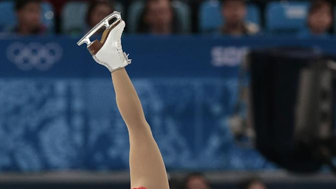 Kirsten Moore-Towers and Dylan Moscovitch of Canada compete in the pairs short program figure skating competition at the Iceberg Skating Palace during the 2014 Winter Olympics, Tuesday, Feb. 11, 2014, in Sochi, Russia