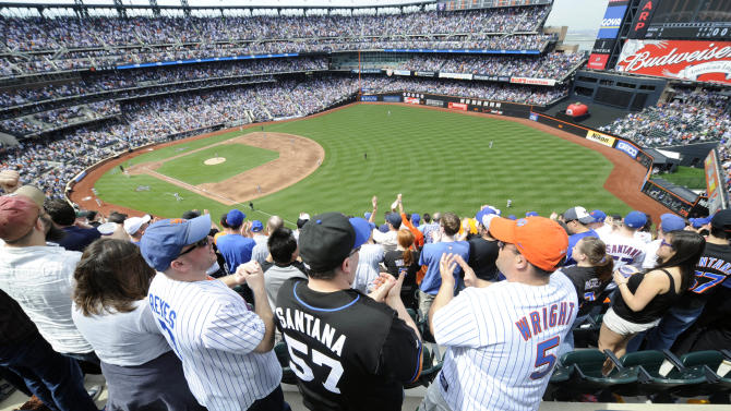 FILE- In tis April 5, 2010, file photo, New York Mets' fans celebrate after the Mets' David Wright hit a two-run home run in the first inning of a baseball game against the Florida Marlins at Citi Field in New York.  A person familiar with the announcement says Major League Baseball will announce Wednesday, May 16, 2012, that the New York Mets will host the 2013 All-Star game at Citi Field. The person spoke on condition of anonymity on Tuesday, May 15, because MLB did not reveal the purpose of Wednesday's news conference at City Hall in New York.  (AP Photo/Henny Ray Abrams, File)