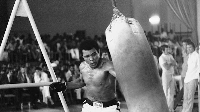 FILE - In this October 1974 file photo taken by Associated Press photographer, Muhammad Ali works out before his bout against George Foreman in Zaire. Faas, a prize-winning combat photographer who carved out new standards for covering war with a camera and became one of the world's legendary photojournalists in nearly half a century with The Associated Press, Thursday May 10, 2012. He was 79. (AP Photo/Horst Faas, File)