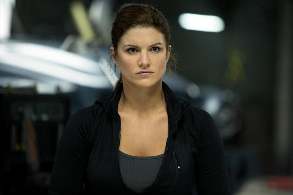 "This film publicity image released by Universal Pictures shows Gina Carano in a scene from ""Fast & Furious 6."" (AP Photo/Universal Pictures, Giles Keyte)"
