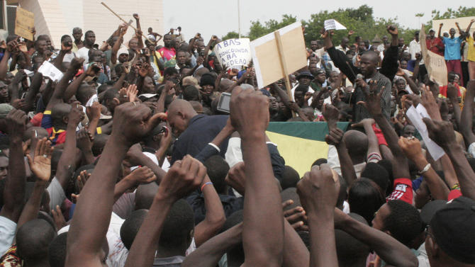 Protesters take to the streets in Bamako, Mali, Monday May 21, 2012. They were protesting Dioncounda Traore's nomination to  transitional president for the next 12 months. The junta led by Capt. Amadou Sanogo  had been opposed to the extension of the interim president's term, which under the Malian constitution was due to run out on Tuesday. ECOWAS had threatened to reimpose sanctions on Mali if the junta did not stop interfering in the transition. (AP Photo/Harouna Traore)