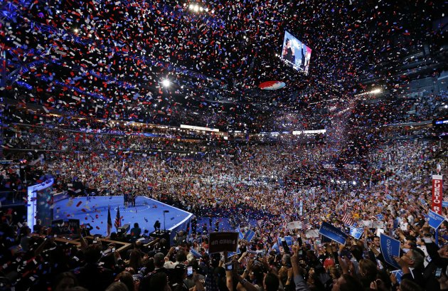 President Barack Obama and his family and Vice President Joe Biden and his family celebrate their nominations as the confetti falls at the conclusion of the Democratic National Convention in Charlotte, N.C., on Thursday, Sept. 6, 2012. (AP Photo/Carolyn Kaster)