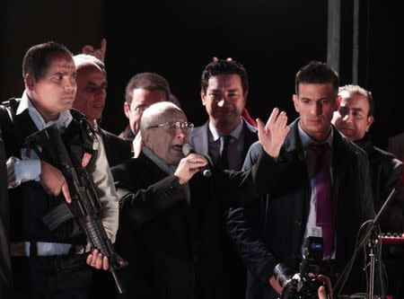 Beji Caid Essebsi, Nidaa Tounes party leader, gestures outside the party headquarters in Tunis