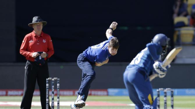 England's Woakes bowls to Sri Lanka's Dilshan during their Cricket World Cup match in Wellington