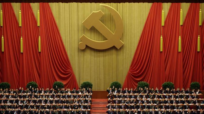 China's top leaders raise their hands to approve work reports during the closing ceremony for the 18th Communist Party Congress at the Great Hall of the People in Beijing Wednesday Nov. 14, 2012. (AP Photo/Ng Han Guan)