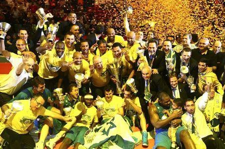 Maccabi Electra Tel Aviv players celebrate after winning the Euroleague Final Four final basketball game against Real Madrid, in Milan