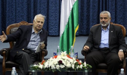Palestinian Central Election Commission chief Hanna Nasser (left) holds talks with Hamas leader Ismail Haniya