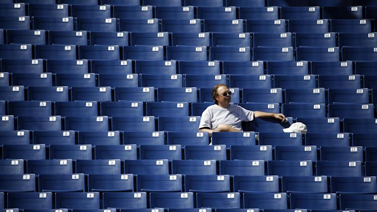 A fan waits for the start of a game before an exhibition spring training baseball game between the Milwaukee Brewers and the San Diego Padres Friday, March 7, 2014, in Phoenix. (AP Photo/Morry Gash)