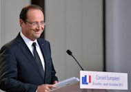 <p>French President Francois Hollande gives a press conference at the end of the first day of a EU summit in Brussels early on October 19. EU leaders vowed Friday to set up a banking union during the course of 2013 after a Franco-German spat held up agreement on exactly when this vital crisis-fighting tool might come into force</p>