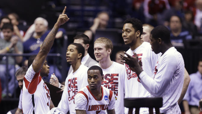 Louisville players react on the bench as they watch the end of a regional semifinal against Oregon in the NCAA college basketball tournament, Friday, March 29, 2013, in Indianapolis. Louisville won 77-69. (AP Photo/Michael Conroy)