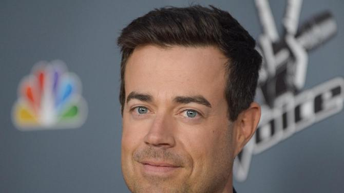 """FILE - In this March 20, 2013 file photo, Carson Daly arrives at the 4th season premiere screening of """"The Voice"""" at the TCL Theatre, in Los Angeles. NBC said Wednesday, April 10, 2013,  that  """"Last Call with Carson Daly"""" has been renewed for a 13th season. (Photo by Richard Shotwell/Invision/AP, File)"""