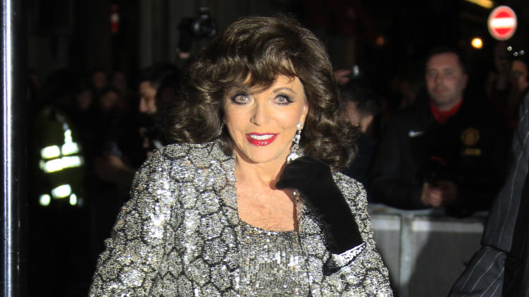 Joan Collins arrives for the press viewing of Viva Forever!, a musical based on the songs of the Spice Girls, at a theater in central London, Tuesday, Dec. 11, 2012. (Photo by Joel Ryan/Invision/AP)