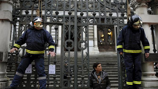 Firefighters take part in a protest in front of the regional parliament of Asturias to demand better organization and more staff in Oviedo