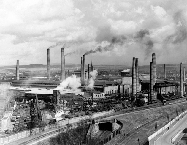 FILE - In this Aug. 29, 1938 file photo, smoke rises from smokestacks at Skodas main foundry in Pilsen, Czechoslovakia. A new study looking at 11,000 years of climate temperatures shows the world in 