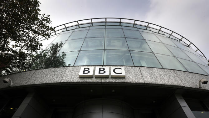 A sign is seen at the entrance to a building at the BBC Television Centre, in London Wednesday, Oct. 24, 2012. The BBC is facing questions over sexual abuse allegations against former television presenter Jimmy Savile. (AP Photo/Kirsty Wigglesworth)
