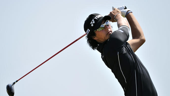 Japanese golfer Ryo Ishikawa watches his drive during practice for the 140th British Open Golf championship at Royal St.George's in Sandwich, Kent, south east England, on July 11, 2011.  AFP PHOTO / GLYN KIRK (Photo credit should read GLYN KIRK/AFP/Getty Images)