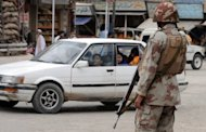 Pakistani paramilitary soldiers stand guard on a street in Quetta, the provincial capital of Baluchistan province, on June 8, 2012. Gunmen stormed a checkpoint in Pakistan's insurgency-hit southwestern province of Baluchistan on Saturday and shot dead seven soldiers, officials said