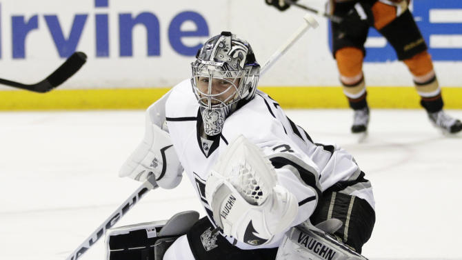 FILE - In this Feb. 27, 2015, file photo, Los Angeles Kings goalie Martin Jones makes a save during the second period of an NHL hockey game against the Anaheim Ducks in Anaheim, Calif. Jones was at the top of San Jose's list as general manager Doug Wilson went into the offseason searching for a starting goaltender. As soon as Jones was dealt from rival Los Angeles to Boston, Wilson saw his opportunity to get him. Jones was traded for the second time in five days on Tuesday, June 30, 2015, getting dealt from Boston to the Sharks for a 2016 first-round pick and unsigned forward prospect Sean Kuraly. (AP Photo/Jae C. Hong, File)