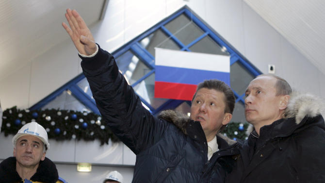 FILE - In this Wednesday, Jan, 2, 2008 file photo Russian President Vladimir Putin, right, listens to the state-controlled natural gas monopoly Gazprom CEO Alexei Miller as they tour the newly opened alpine ski center that will be used in the 2014 Olympics at Krasnaya Polyana in the southern Russian Black Sea resort of Sochi. The names of Russia's business powerhouses have taken over the mountains of Sochi, now the home of Potanin's slope, Gazprom's gondola lift and Sberbank's ski jump. These names, used by local residents and an army of construction workers, leave no doubt about who is paying for next year's Winter Games. (AP Photo/ RIA Novosti, Dmitry Astakhov, Presidential Press Service, File)