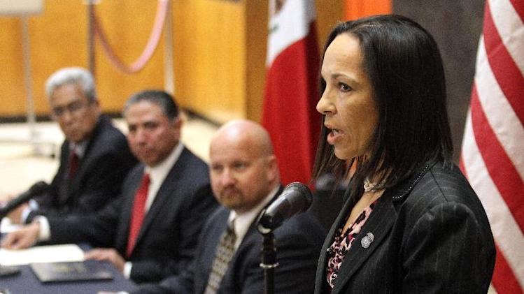 Homeland Security Investigations Assistant Director of Domestic Operations Janice Ayala speaks during a news conference Thursday, Oct. 25, 2012 at the Mexican Consulate where the United States returned seized artifacts to Mexico. More than 4,000 archaeological artifacts looted from Mexico and seized in the U.S. were returned to Mexican authorities on Thursday in what experts say is one of the largest repatriation ever made between the neighboring countries. (AP Photo/The El Paso Times, Mark Lambie)