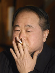 In this photo taken Tuesday Dec. 27, 2005, Chinese writer Mo Yan smokes during an interview in Beijing, China. Mo won the Nobel Prize in literature on Thursday, Oct. 11, 2012. (AP Photo) CHINA OUT