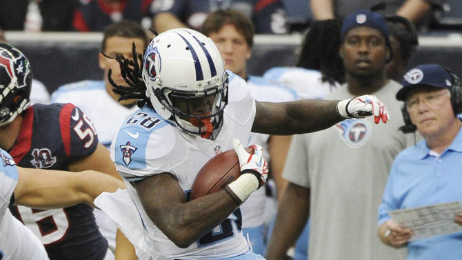 Tennessee Titans running back Chris Johnson (28) is caught by Houston Texans defenders  Connor Barwin (98) and  Johnathan Joseph (24) in the second quarter of an NFL football game Sunday, Sept. 30, 2012, in Houston. (AP Photo/Dave Einsel)
