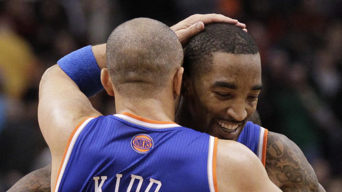 New York Knicks' Jason Kidd (5) celebrates with teammate J.R. Smith after Smith hit a game-winning basket against the Phoenix Suns during the second half of an NBA basketball game on Wednesday, Dec. 26, 2012, in Phoenix. The Knicks won 99-97. (AP Photo/Matt York)