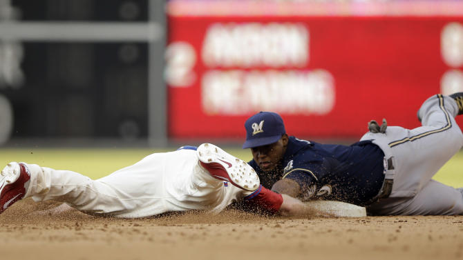 Philadelphia Phillies pinch-runner Kyle Kendrick, left, dives back to second base on a pick-off attempt as Milwaukee Brewers shortstop Jean Segura applies the tag in the ninth inning of a baseball game, Saturday, June 1, 2013, in Philadelphia. Kendrick was called out on the play. Milwaukee won 4-3. (AP Photo/Matt Slocum)