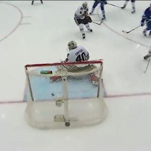 Phil Kessel puts the puck past Simpson
