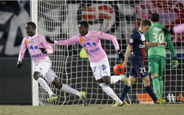 Sougou and teammate N'Sikulu of Evian Thonon Gaillard celebrate after scoring against Paris St-Germain during their French Ligue 1 match in Annecy