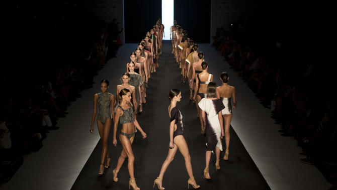 Models wear creations from the Lenny summer collection during Fashion Rio in Rio de Janeiro, Brazil, Wednesday, April 17, 2013. Known for her use of muted earth tones and the clean, almost architectural lines of her swimwear, Lenny Niemeyer sells some 350,000 pieces a year, mostly at her 26 boutiques throughout the country, but also at multi-mark shops in Britain, France, the Bahamas and in 23 U.S. states. (AP Photo/Felipe Dana)
