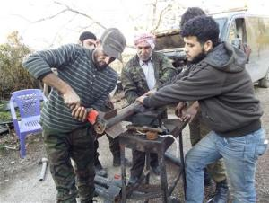 Free Syrian Army fighters prepare homemade rockets in Latakia countryside