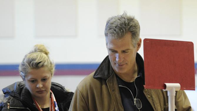U.S. Sen. Scott Brown, R-Mass., picks up his ballot with his daughter Arianna, left,  to cast his vote in Wrentham, Mass., on Election Day, Tuesday, Nov. 6, 2012. Brown is facing Democratic candidate Elizabeth Warren for the U.S. Senate.  (AP Photo/Gretchen Ertl)