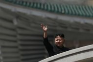 North Korea leader Kim Jong-un waves during a military parade in Pyongyang