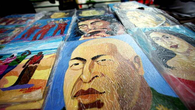 In this Jan. 22, 2013 photo, a street artist's painting of Venezuela's President Hugo Chavez sits for sale in Caracas, Venezuela. While Venezuela's sick president recuperates from surgery in Cuba, in Venezuela he is alive and well, at least in spirit. (AP Photo/Fernando Llano)