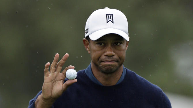 CORRECTS TO EAGLE, NOT BIRDIE - Tiger Woods acknowledges the gallery after making an eagle putt on the 18th hole at the north course of the Torrey Pines Golf Course during the second round of the Farmers Insurance Open golf tournament, Friday, Jan. 25, 2013, in San Diego. (AP Photo/Gregory Bull)